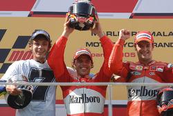 Podium: race winner Loris Capirossi with Valentino Rossi and Carlos Checa