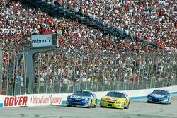 Jimmie Johnson takes the checkered flag ahead of Kyle Busch