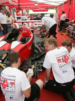 Horag-Lista Racing crew members work on the wrecked #27 Lola B05/40 Judd