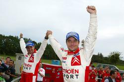 2005 WRC champions Sébastien Loeb and Daniel Elena celebrate