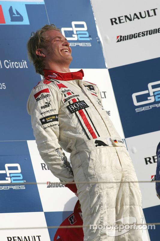 Podio: ganador de la carreracampeón GP2 Series 2005 Nico Rosberg celebra