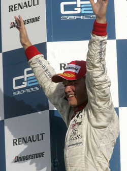 Podium: race winner Nico Rosberg celebrates