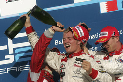 Podium: champagne for Nico Rosberg, Ernesto Viso and Alex Premat
