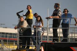 Crew members watch track action from atop the team haulers