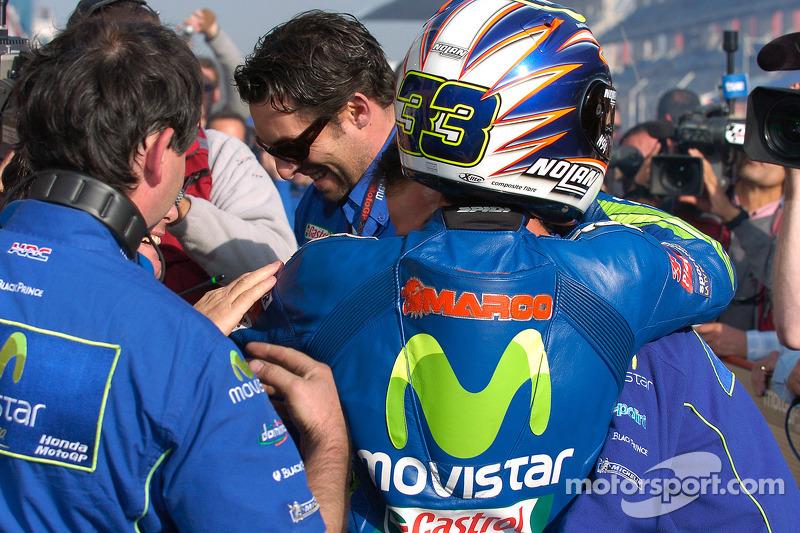 Race winner Marco Melandri celebrates with Fausto Gresini