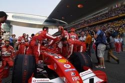 Ferrari team members on the starting grid