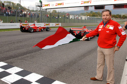Jean Todt gives the start to Michael Schumacher and Rubens Barrichello