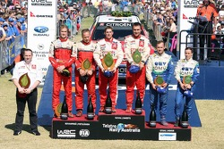 Podium: rally winners François Duval and Sven Smeets, with second place Harri Rovanpera and Risto Pietilainen, and third place Manfred Stohl and Ilka Minor