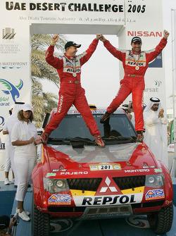 Podium: winners Stéphane Peterhansel and Jean-Paul Cottret celebrate