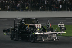 The camera car for the movie 'High, Wide, and Handsome' pulls onto pitroad after the parade laps