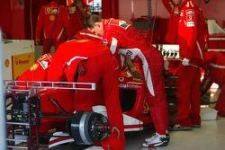 Michael Schumacher and Ferrari team members inspect the Ferrari