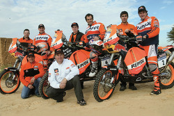Team Repsol KTM: Marc Coma, Carlo de Gavardo and Giovanni Sala pose with Repsol KTM team members