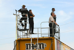 M&Ms Ford crew members watch test action from atop their transporter