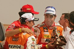 Car category podium: third place Nani Roma and Henri Magne