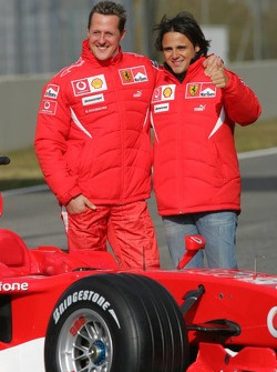 Michael Schumacher and Felipe Massa with the new Ferrari 248 F1