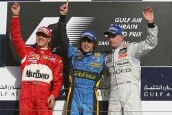 Podium: race winner Fernando Alonso with Michael Schumacher and Kimi Raikkonen