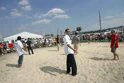 Beach volley match: Guy Cosmo looks for the volley ball
