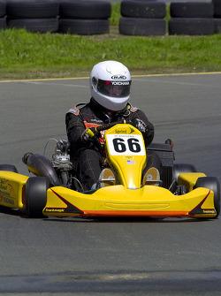 Scott Speed drives a kart