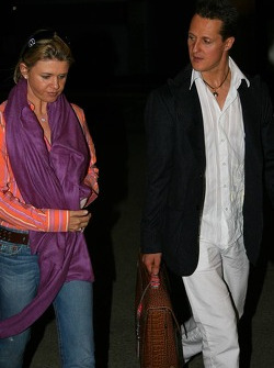 Michael Schumacher and wife Corina leave the circuit late