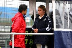 Nico Rosberg talks with a Bridgestone engineer