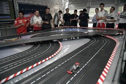Chilled Thursday: visitors and mechanics playing with carrera remote control cars
