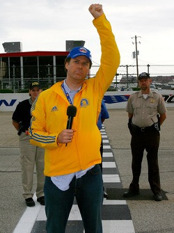 Actor Will Ferrell gives signal to start engines at the start