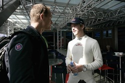 Scott Speed with his manager Glenn Hinshaw in the Red Bull Energy Station