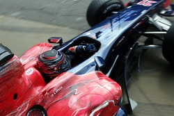 Scott Speed drives out of the garage