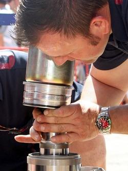 A Red Bull Racing crew member at work