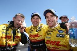Race winners Timo Bernhard and Romain Dumas celebrate