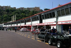Team set up their garages in the Monaco Pitlane