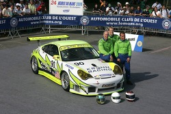 Jorg Bergmeister, Tracy Krohn, and Nic Jonsson pose with the White Lightning Racing Porsche 911 GT3 RSR