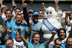 Fernando Alonso celebrates with the team and Michelins 100th GP victory