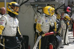 Olivier Gavin and the #64 Corvette Racing Corvette C6R crew wait for their pit stop