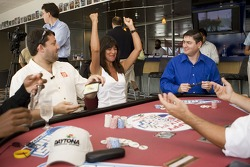 Tony Stewart paid a visit to Daytona International Speedway to play poker and publicize the Pepsi 400, while Holly Cain of the Seattle Post-Intelligencer celebrates her winning strategy