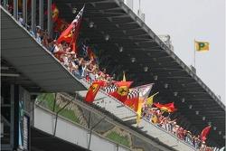 Tifosi celebrate Michael Schumacher's pole position