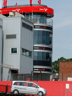 Control tower of Brands Hatch circuit whilst a DTM media shuttle is driving by