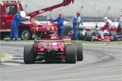 Felipe Massa passes the scene of the accident at turn 1