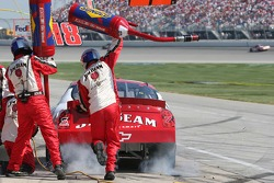 Gas and smoke appear as Robby Gordon finishes his pitstop