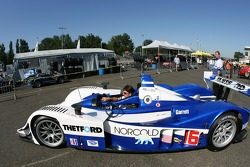 Dyson Racing crew members take their car to pitlane