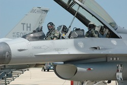 Col. Chris 'Bert' Colbert and Tony Raines prepare for flight