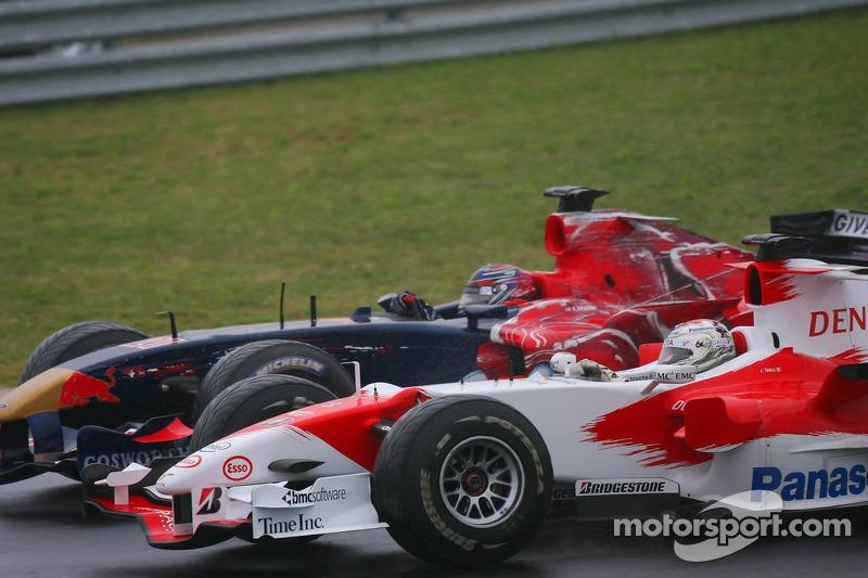 Jarno Trulli y Scott Speed