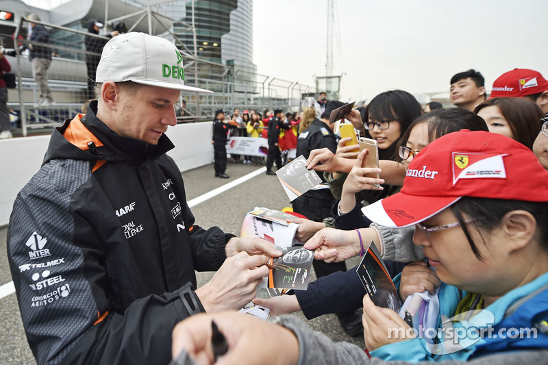 Nico Hulkenberg Sahara Force India F1 signs autographs for the fans