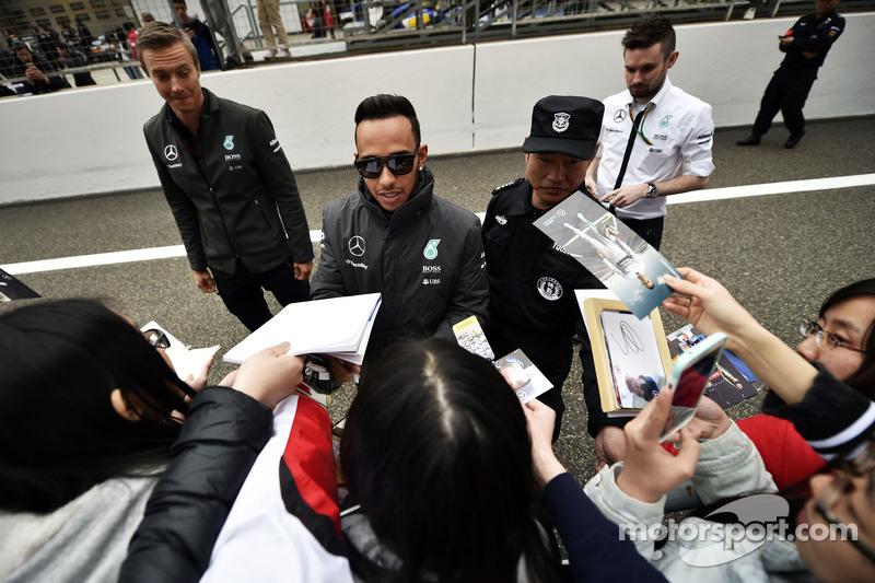 Lewis Hamilton Mercedes AMG F1 signs autographs for the fans