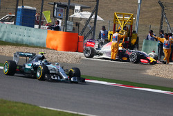 Daniil Kvyat, Red Bull Racing RB11 retired from the race with a blown engine, and is passed by Nico Rosberg, Mercedes AMG F1 W06