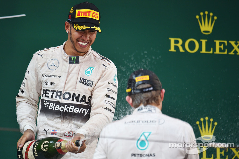 Race winner Lewis Hamilton Mercedes AMG F1 celebrates with the champagne on the podium with second placed team mate Nico Rosberg Mercedes AMG F2