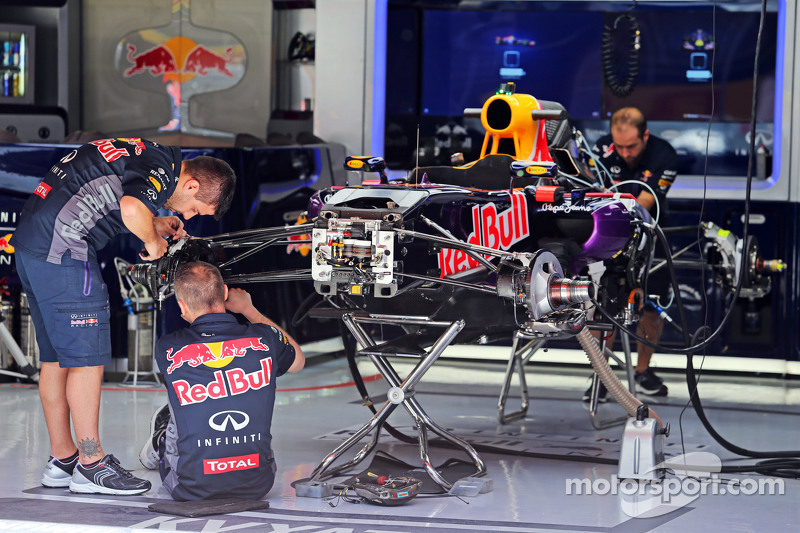 Red Bull Racing RB11 being prepared in the pit garage