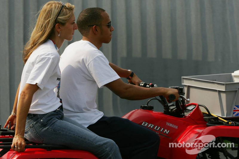Lewis Hamilton gives a girl a ride on his quad bike