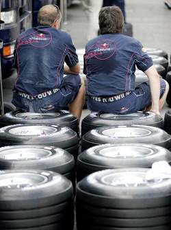 Red Bull Racing crew members sitting on Michelin tyres