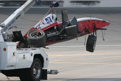 Bobby Wilson's damaged car returns to the garage area